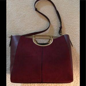 Top shop metal handle handbag.